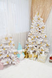 Christmas tree with presents underneath in living room royalty free stock photo