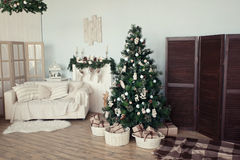 Christmas tree with presents underneath in living room. Vintage сhristmas tree with presents underneath in living room royalty free stock image