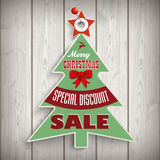 Christmas Tree Price Sticker Wood Pin. Price sticker for the christmas sale on the wooden background Royalty Free Stock Photos