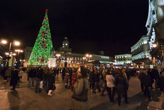 Christmas tree in Puerta del Sol. At night with people and illuminated buildings - Madrid 2009 Royalty Free Stock Photo