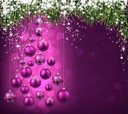 Christmas tree with purple christmas balls. Royalty Free Stock Image