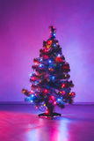 Christmas tree with purple lights Royalty Free Stock Photography