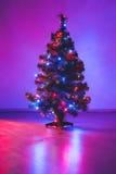 Christmas tree with purple lights garland Royalty Free Stock Photo