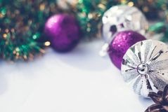 New year theme: Christmas tree purple and silver decorations, balls on white retro wood background. Christmas tree purple and silver decorations, balls on white royalty free stock photos