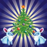 Christmas tree, and rabbits. Royalty Free Stock Photos