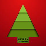 Christmas tree on red background Stock Images