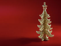 Christmas tree on red background Stock Photography