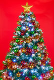 Christmas tree red background Stock Photos