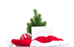 Christmas tree with red ball and santa hat Royalty Free Stock Photos