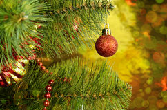Christmas tree with red ball and tinsel. On a colorful background Stock Photography