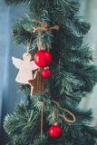 Christmas tree with red balls and angel. Christmas and New Year. Tree decorated close up Stock Images