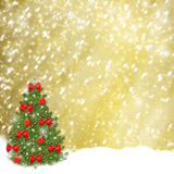 Christmas tree with red balls and beautiful bows. On abstract snowy background Royalty Free Stock Images