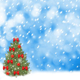 Christmas tree with red balls and beautiful bows. On abstract snowy background Stock Photography