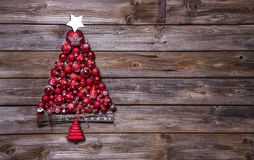 Christmas tree of red balls on wooden background. stock photos