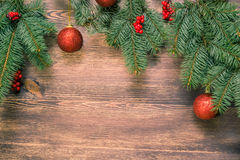 Christmas tree with red balls on wooden surface Royalty Free Stock Image