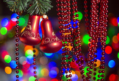 Christmas-tree red bell decorations against nice lights background Royalty Free Stock Image