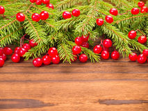 Christmas tree and red berries on the dark background Stock Photography