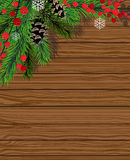 Christmas tree  with red berries. Christmas fir tree and red berries on wooden board Royalty Free Stock Photo