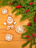 Christmas tree and red berries and Santa with gifts cookies Stock Photography