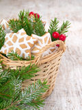 Christmas tree,red berries and star cookies Royalty Free Stock Image