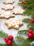 Christmas tree and red berries and star cookies Royalty Free Stock Photography