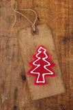 Christmas tree red candy on retro paper tag Royalty Free Stock Images