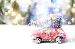 Christmas tree on red car toy with snow. Winter holiday celebration and Happy new year concept, copy space stock images
