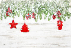 Christmas tree with red decoration and falling snow Royalty Free Stock Photography