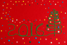 2016 Christmas tree on red felt. Abstraction Christmas 2016 red background stock photo