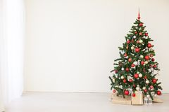 Christmas tree with red gifts in the white room Christmas. 2 Royalty Free Stock Photos