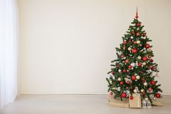 Christmas tree with red gifts in the white room Christmas Royalty Free Stock Photography