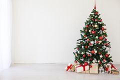 Christmas tree with red gifts in the white room Christmas Royalty Free Stock Images