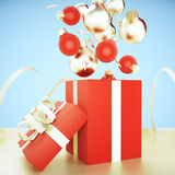Christmas tree red and gold balls, gold stars and red gift boxes Stock Photos
