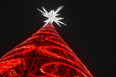 Christmas tree with red lights and white star. Outdoors Stock Images