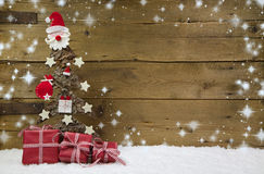 Christmas tree with red presents and snowflakes. Stock Image