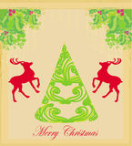 Christmas tree and red reindeer Royalty Free Stock Images