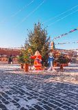 Christmas tree on the Red Square. New Year`s scenery. Ded Moroz and Snegurochka. New Year`s Fair. stock photos
