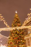 Christmas tree on red square stock image