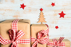 Christmas tree, red stars and gift boxes Royalty Free Stock Photo