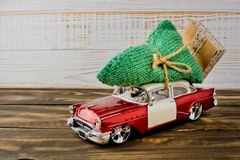 Christmas tree on red toy car, Merry Christmas. Royalty Free Stock Photo