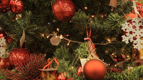 Christmas tree with red toys and decorations background. Close-up. In the hypermarket. stock video footage