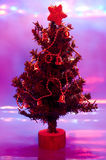 Christmas tree with red and violet light  Royalty Free Stock Images