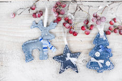 Christmas tree, reindeer and star on a branch with berries Stock Photography