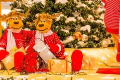 Christmas tree, Reindeers preparing presents for Christmas.  royalty free stock image