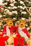 Christmas tree, Reindeers preparing presents for Christmas.  royalty free stock photos