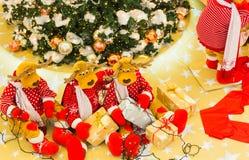 Christmas tree, Reindeers preparing presents for Christmas.  royalty free stock images