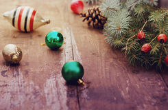 Christmas tree with retro decorations on rustic wooden boards, vintage toned seasonal background Royalty Free Stock Photography