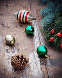 Christmas tree with retro decorations on rustic wooden boards, vintage toned seasonal background Stock Photos