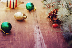 Christmas tree with retro decorations on rustic wooden boards, vintage toned seasonal background Royalty Free Stock Photos