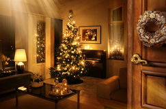 Christmas tree room behind the door Stock Photos
